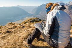 Hiker studying a map. Stock Image