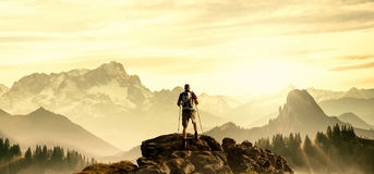 Hiker on summit Royalty Free Stock Photography
