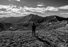 Hiker on the summit of Cupid Peak, Loveland Pass. Colorado Rocky Mountains royalty free stock images