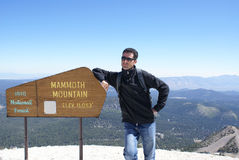 Hiker on Summit of Mammoth Mountain royalty free stock image