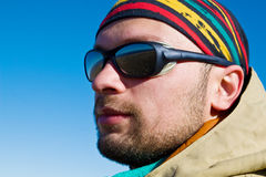 Hiker in sunglasses. And colourful bandana Royalty Free Stock Photos