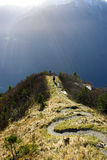 Hiker in Swiss Alps mountains Royalty Free Stock Photos