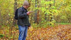 Hiker with tablet PC in the park stock footage