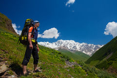 Hiker take a rest during hiking. In Caucasus mountains, Georgia Royalty Free Stock Image