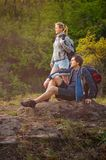 Hiker take a rest during hiking. Travel, vacation, holidays and royalty free stock image