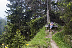 Hiker takes a break and enjoys the view Royalty Free Stock Image