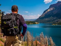 A Hiker Stops to Take in the Beauty that is St. Mary Lake stock image