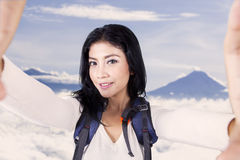 Hiker takes picture on the mountain peak Stock Image