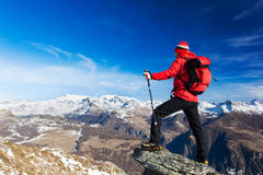 Hiker takes a rest admiring the mountain landscape. Monte Rosa M Stock Images