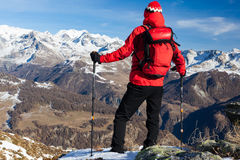 Hiker takes a rest admiring the mountain landscape. Monte Rosa M Royalty Free Stock Photography