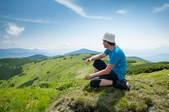 Hiker takes rest during hiking Stock Photo