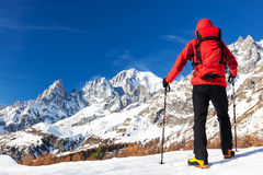 Hiker takes a rest looking at Mont Blanc panorama during the fam Stock Images