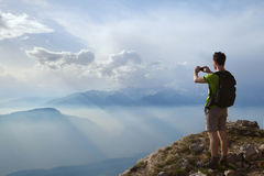 Hiker taking photo Stock Photography