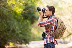 Hiker taking photos mountain Stock Photos