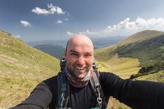 Hiker taking a selfie while out trekking Stock Images
