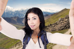 Hiker taking selfie photo at mountainside Stock Images