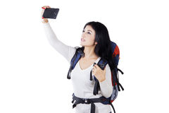 Hiker taking selfie picture in studio Stock Images