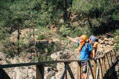 Hiker taking selfie on the wooden bridge in Turkey. Male traveler taking selfie standing on a wooden bridge in the mountains Royalty Free Stock Images