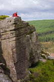 A hiker taking in Simonside Crag Views Stock Photography