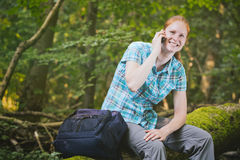 Hiker Talking on a Mobile Phone in Nature Royalty Free Stock Photography