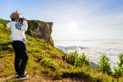 Hiker teen girl photographing Stock Photo