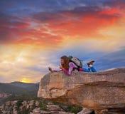 Hiker teen girl selfie phone on peak of mountain. Hiker teen girl selfie smartphone on peak of mountain at sunset stock images