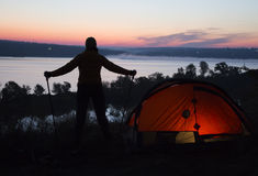Hiker, tent and sunrise Royalty Free Stock Image