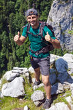 Hiker with thumbs up Royalty Free Stock Image