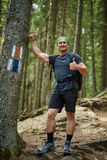 Hiker with thumbs up in the woods Royalty Free Stock Photos
