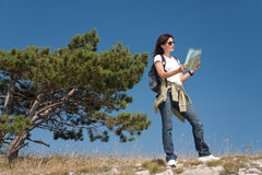 Hiker with thw map Stock Photos