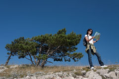 Hiker with thw map Stock Images