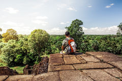 Hiker on top of ancient ruins looking at view. Success Freedom Concept Stock Photography
