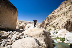Hiker on the top of boulder Royalty Free Stock Images