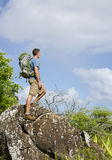 Hiker On Top of a Boulder Royalty Free Stock Images