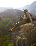 Hiker on top of the hill Stock Photo