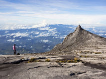 Hiker at the top of Mount Kinabalu in Sabah, Malaysia stock images