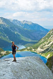 Hiker on top of mountain Royalty Free Stock Image