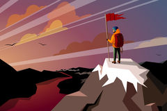 Hiker On Top Mountain with flag. Sunset scene Stock Photography