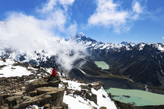 Hiker on top of mountain looking at Mount Cook Stock Image