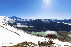 Hiker on top of mountain looking at Mount Cook Royalty Free Stock Images