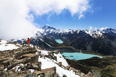 Hiker on top of mountain looking at Mount Cook Royalty Free Stock Photos