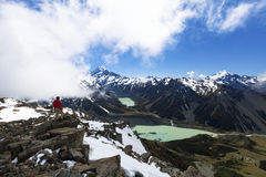 Hiker on top of mountain looking at Mount Cook Royalty Free Stock Photo