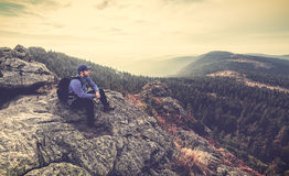 Hiker on Top of a Mountain with Woodland Stock Images