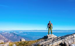 Hiker on the top in mountains. Travel sport lifestyle concept stock photography