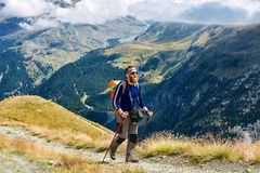 Hiker at the top of a pass Royalty Free Stock Images