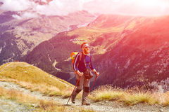 Hiker at the top of a pass Stock Photos