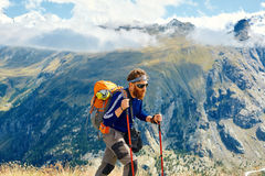 Hiker at the top of a pass Stock Images
