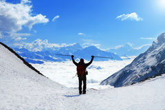 Hiker at the top of a pass Stock Photo