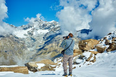 Hiker at the top of a pass Stock Image
