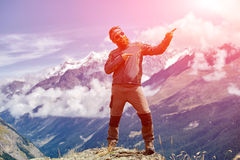 Hiker at the top of a pass Royalty Free Stock Image
